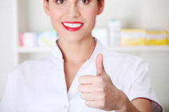 Young nurse, doctor showing ok gesture. Royalty Free Stock Photography