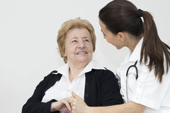 Young nurse and female senior patient Royalty Free Stock Images