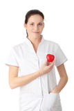 Young nurse with heart in her hand Stock Images