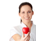 Young nurse with heart in her hand Royalty Free Stock Photos