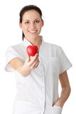 Young nurse with heart in her hand Stock Photography