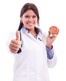 Young nurse holding apple Royalty Free Stock Photos