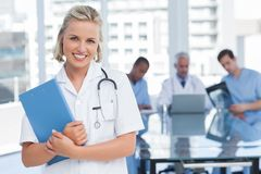 Young nurse holding file Stock Photos