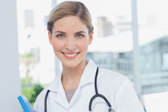 Young nurse holding a folder Royalty Free Stock Photography