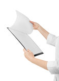 A young nurse is holding in his hand the tablet to take notes. I Royalty Free Stock Photo