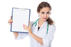 A young nurse is holding in his hand the tablet to take notes Stock Photography