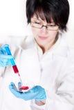 Young nurse holding a syringe. On white Stock Photography