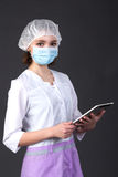 Young nurse holding touch pad Stock Images