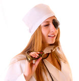 Young nurse with knife near her neck Stock Photo