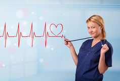 Young nurse listening to abstract pulse with red heart Royalty Free Stock Image