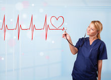 Young nurse listening to abstract pulse with red heart Stock Photography