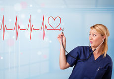Young nurse listening to abstract pulse with red heart Royalty Free Stock Photos