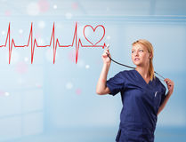 Young nurse listening to abstract pulse with red heart Stock Image