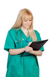 Young nurse with long hair and clipboard stock photo