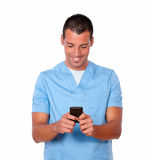 Young nurse man sending a message Stock Images