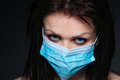 Young nurse in mask Stock Images