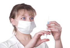 Young nurse in mask with syringe Royalty Free Stock Photography