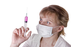 Young nurse in mask with syringe Royalty Free Stock Photo