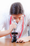 Young Nurse and microscope Stock Photo