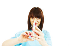 Young nurse is preparing syringe for injection Royalty Free Stock Photos
