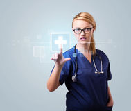 Young nurse pressing modern medical type of buttons Stock Image
