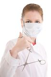 The young nurse with scissors isolated on a white Royalty Free Stock Images