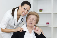 Young  nurse with senior woman Stock Image