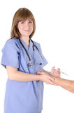Young nurse and syringe Royalty Free Stock Images