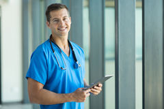 Young nurse tablet pc. Cheerful young nurse with tablet pc in office Stock Images
