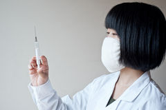 Young nurses in the operating syringes, young wome Stock Photos