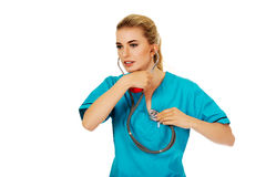 Young nursre or female doctor listen her own heart.  stock photo