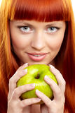 Young nwoman with apple Stock Photos