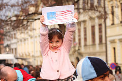 Young Obama supporter. PRAGUE, CZECH REPUBLIC - APRIL 5: A young girl shows off an American flag painting. Obama delivered his speech about nuclear disarmament Stock Photos