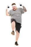 Young obese man holding dumbbells with facial expression. Isolated on white Stock Image