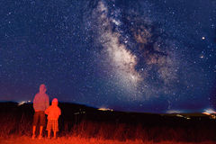 Young observers looking at the milky way stock photo
