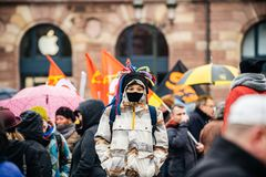 Young oby at protest in France wearing mask royalty free stock photography