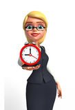 Young office girl with table clock Stock Photo