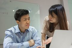 Young office lady asking workmate for help royalty free stock photo