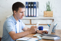 Young office man looking at smartphone screen Royalty Free Stock Image