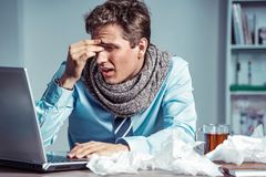 Young office man with pain in his head or an eye. Photo of sick man suffering from stress or a headache grimacing in pain. Business concept royalty free stock photos