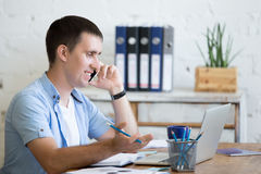 Young office man on phone Stock Photos