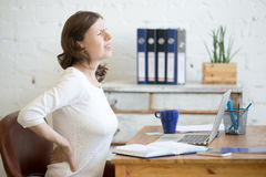 Young office woman feeling backache Royalty Free Stock Images