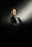 Young Office Woman Illuminated with Light on Black Royalty Free Stock Photos
