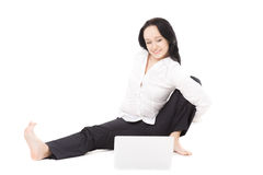 Young office woman with laptop exercising on white background Stock Photo