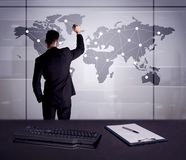 Business person drawing dots on world map. A young office worker drawing on world map and connecting dots with lines, presenting marketing sterategy at office Stock Image