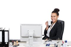 Young office worker drinks a cup of coffee Stock Images