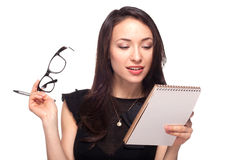 Young office worker in glasses with notebook Stock Photos