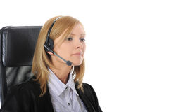 Young office worker with headset. Stock Image