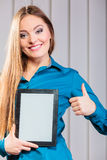 Young office worker hold tablet with thumb up. Royalty Free Stock Image