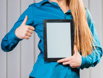 Young office worker hold tablet with thumb up. Royalty Free Stock Photo
